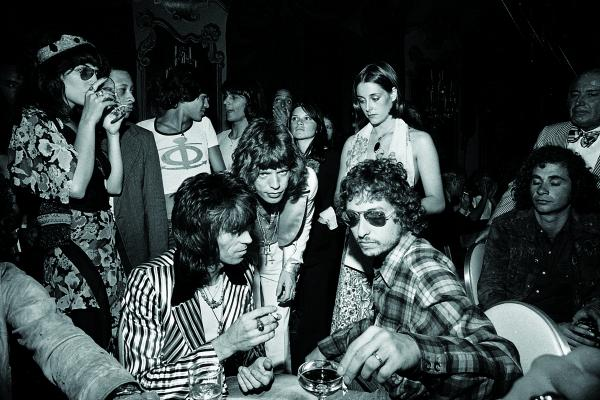 "Mick Jagger's 29th birthday party. ""At the party I photographed Mick and Keith with Bob Dylan at a time when Dylan sightings were extremely rare. Why was he there? Maybe the folk-rock icon was curious to meet up with rock 'n' roll's greatest icons-in-the-making."""