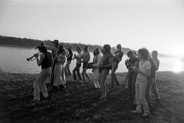 """Merry players"" on the beach, Bob playing trumpet. Thanksgiving, 1975, Sturbridge, Mass."