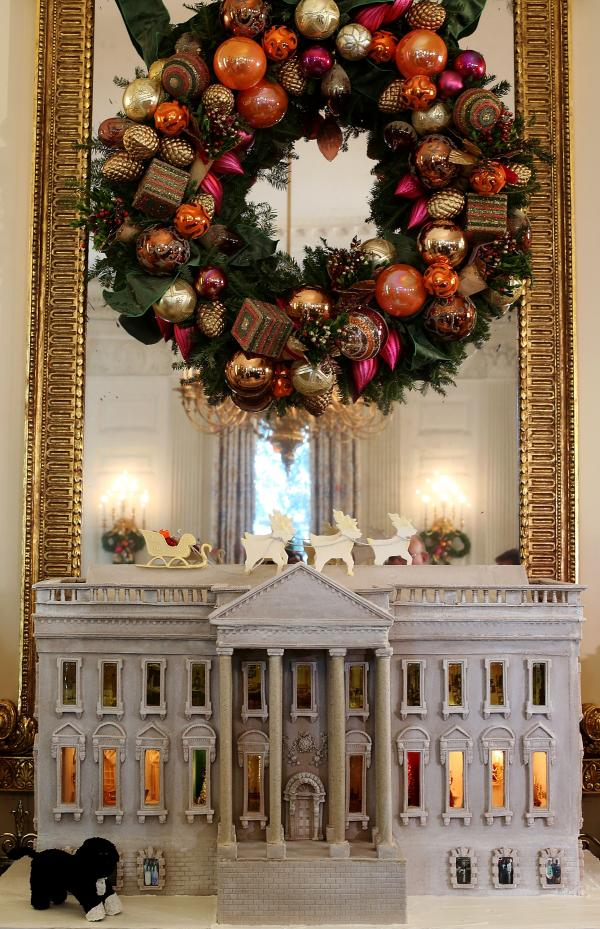 A nearly 300-pound White House gingerbread house sits in the State Dining Room.