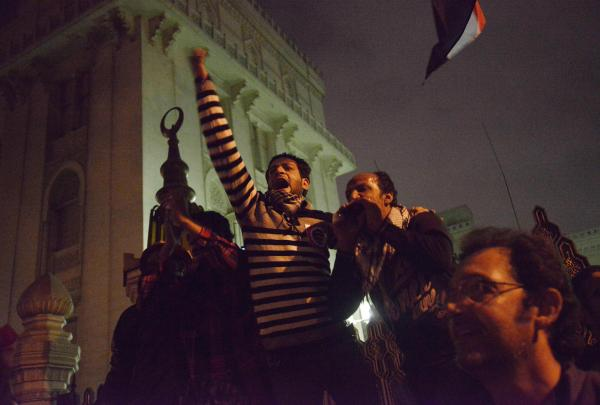 Egyptian protesters shout slogans as they demonstrate outside of the presidential palace in Cairo Tuesday.