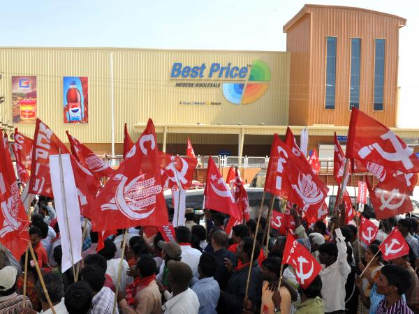 Indian leftist activists rally in front of a Best Price store, owned by Wal-Mart and its Indian partner, Bharti, in Hyderabad in November. The rally was organized to protest foreign direct investment in India's retail sector.