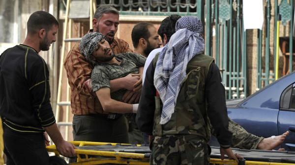 Syrians lift a wounded rebel fighter to take him into a hospital in Aleppo, Syria, in October. Doctors have few supplies to treat wounded fighters in Syria.