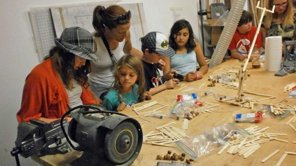 Kids build robots with Popsicle sticks at an Oakland meeting of Hacker Scouts, a group that encourages young people to create do-it-yourself crafts and electronics.