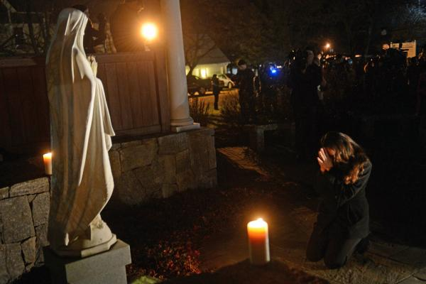 People gather for a prayer vigil at St. Rose Church in Newtown, Conn., on Dec. 14. In the aftermath of such tragedies, many people ask how a benevolent God and suffering can coexist.