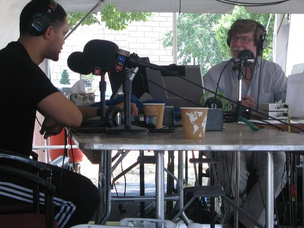 Host Neal Conan chats with comedian Trevor Noah during <em>Talk of the Nation</em>'s live broadcast at the Smithsonian Folklife Festival.