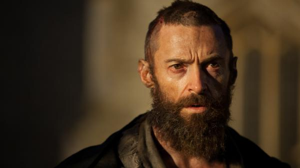 Hugh Jackman uses his Broadway-tested voice to give life to reformed criminal Jean Valjean in an epic adaptation of the stage musical <em>Les Miserables.</em>