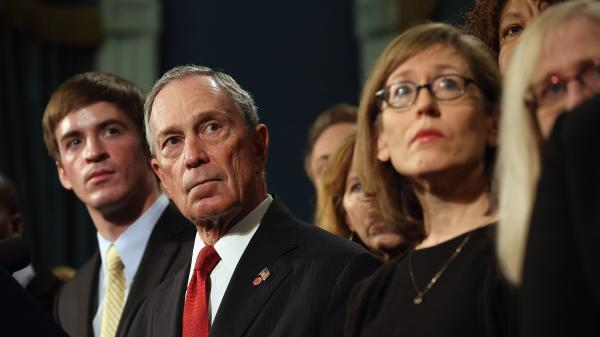 At a news conference last month, New York City Mayor Michael Bloomberg stands with people who have been affected by gun violence.