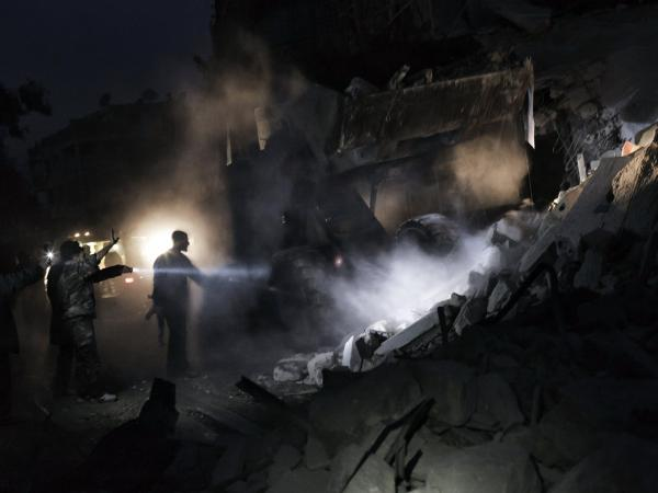 Syrians look for survivors amid the rubble of a building targeted by a missile in the al-Mashhad neighborhood of Aleppo on Jan. 7.