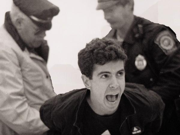 Director and producer David France chronicles the efforts of HIV/AIDS activists in the '80s and '90s in his documentary <em>How to Survive a Plague. </em>Above, AIDS activist Peter Staley is arrested in a scene from the film.<em></em>
