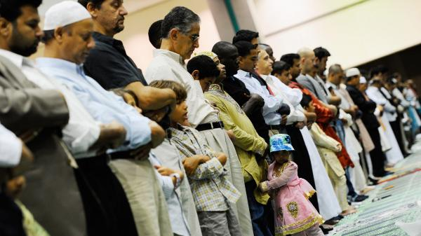 Muslims pray during a special Eid ul-Fitr morning prayer at the Los Angeles Convention Center on Aug. 30, 2011, in Los Angeles.