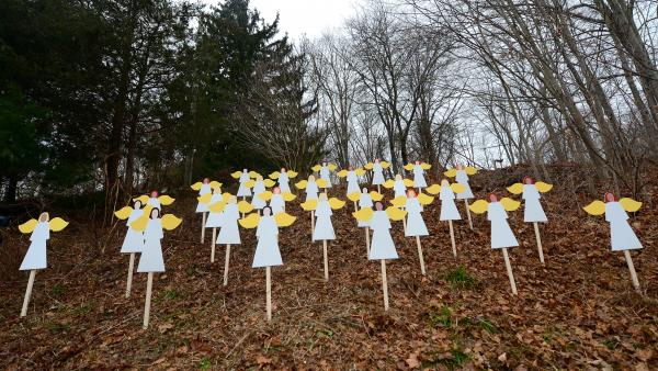 Wooden angels memorialize the victims of Adam Lanza's shooting spree in Newtown, Conn., last December. An upcoming <em>Frontline</em> documentary seeks to provide new details about Lanza and his mother, Nancy.