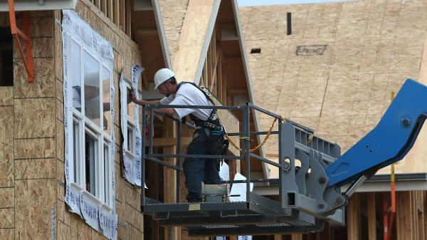 Going up: A construction worker at a housing development in San Mateo, Calif., in June 2012.
