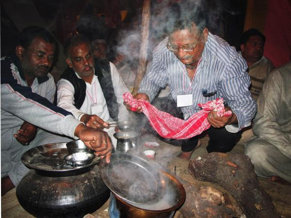 Followers of Kamal prepare tea during the Kumbh Mela.