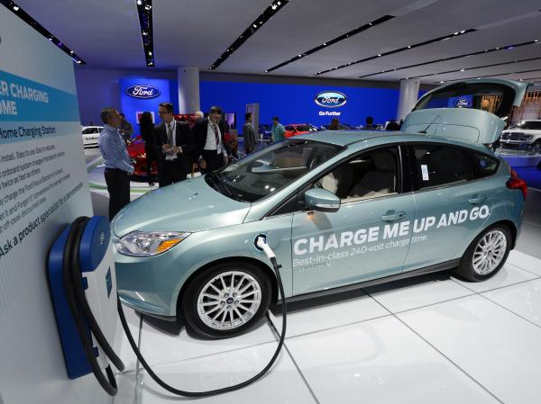 A Ford Focus electric concept car with a home charging unit on display at the 2013 North American International Auto Show in Detroit, Mich., in January.