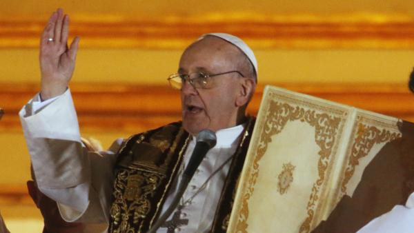 Pope Francis blesses the crowd from the central balcony of St. Peter's Basilica at the Vatican on Wednesday.