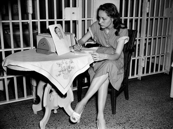 Ruth Ann Steinhagen, then-19, in the Cook County Jail after she shot Philadelphia Phillies first baseman Eddie Waitkus in 1949. On the table: a photo of Waitkus taken in the hospital where he was recovering from his bullet wound. The story of his shooting was the inspiration for Bernard Malamud's novel <em>The Natural</em>. Steinhagen died this past December.