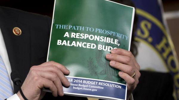 House Budget Committee Chairman Rep. Paul Ryan, R-Wis., holds a copy of his budget plan during a news conference last week. On Thursday, the Republican-controlled House narrowly passed the measure. The Senate is not expected to follow suit.