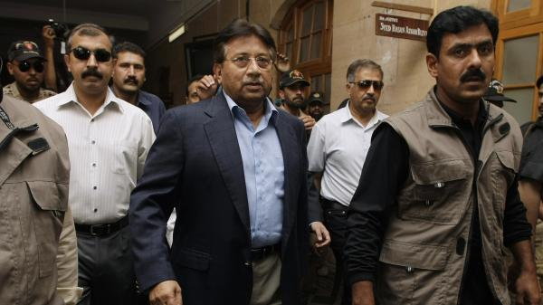 Former Pakistani President Pervez Musharraf (center) arrives in court in Karachi on Friday. An angry lawyer threw a shoe at Musharraf, who was not hit. He faces legal charges following his return to the country after four years in self-imposed exile, police said.