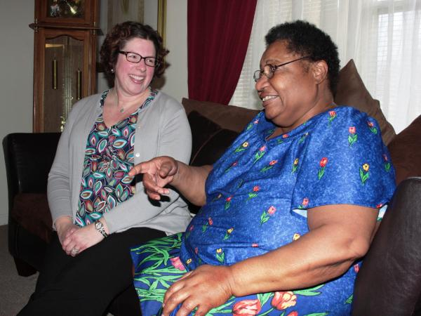 Lawyer Meredith Watts (left) visits client/patient Shirley Kimbrough at her apartment in north Akron, Ohio. Kimbrough is being helped by a program under which lawyers partner up with health providers to supply patients with legal advice.