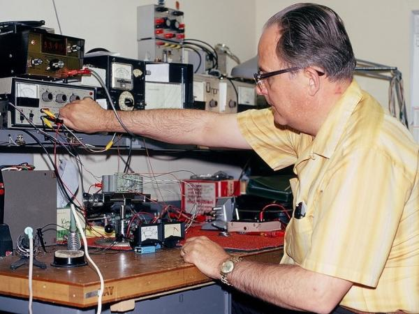 Wayne Hetrich works on the Accu-Peak meter. This device, which NPR had patented, measures loudness.