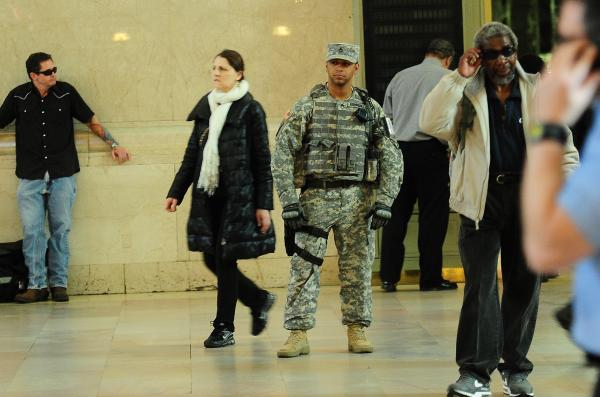 A U.S. soldier patrols at Grand Central station in New York on Tuesday. Safety concerns led to stepped-up security at public places and events after the bombings in Boston.