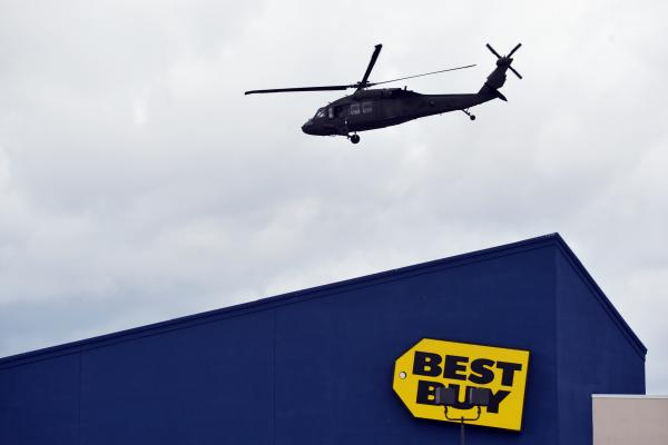 A National Guard helicopter takes off in Watertown, Mass., after landing in a shopping mall as part of search operations for one of the bombing suspects.