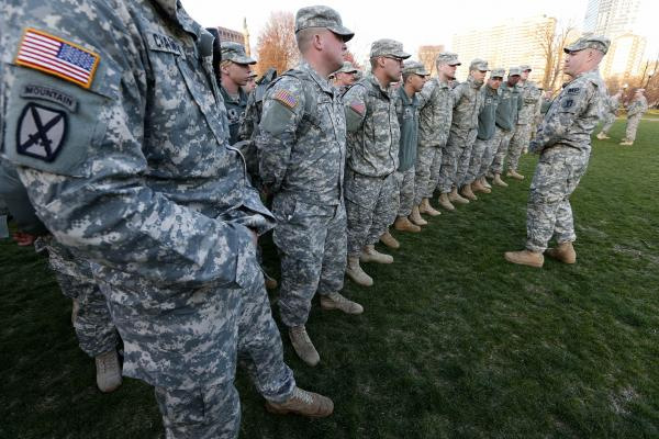 Members of the Massachusetts National Guard wait on Boston Common for orders Monday evening after the deadly explosions near the finish line of the Boston Marathon.