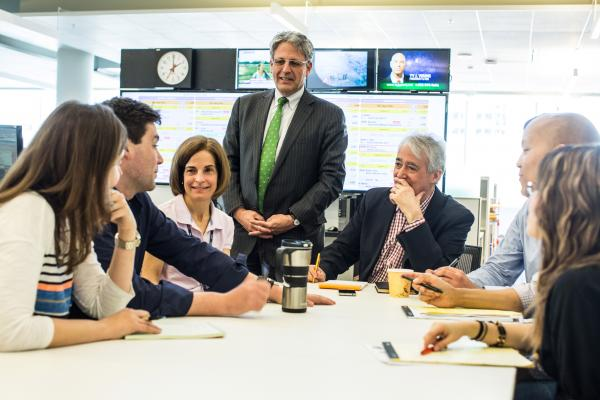 "NPR President and CEO Gary E. Knell greets the staff of <em>Weekend Edition</em> on their first day at the new headquarters. Knell said that this is ""a transformative moment for our staff, Member Stations and audience. The collaborative workspaces and modern, multimedia newsroom will fuel interaction and creativity inside and out."""