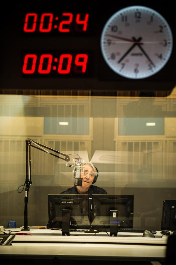 "<em>Weekend Edition</em> Host Scott Simon preps for the first broadcast in the new building on April 13, 2013, from Studio 31. For the program, Susan Stamberg recalls this and previous NPR moves and said, ""It's Oz here, shiny and bright and full of sunlight and free coffee. Once we figure it all out — find the studios, our offices, the restrooms — everything will be better in the new building."""