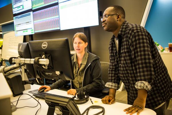 NPR installed an all-digital system at its new headquarters. In going 100 percent digital, NPR will now be able to take advantage of improvements in content generation that are only available with new digitally-based technologies. Here, broadcast recording technicians Stacey Abbott and Greg Gavin work in master control as the first broadcast from the new NPR headquarters goes on the air.