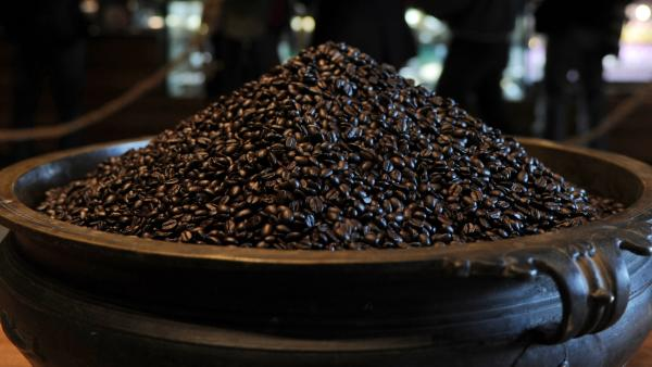 <strong>A Lot Of Beans:</strong> A charity auction of a cup of coffee with Apple CEO Tim Cook has garnered bids topping $600,000. In this file photo, a pot of beans sits in a Starbucks store.