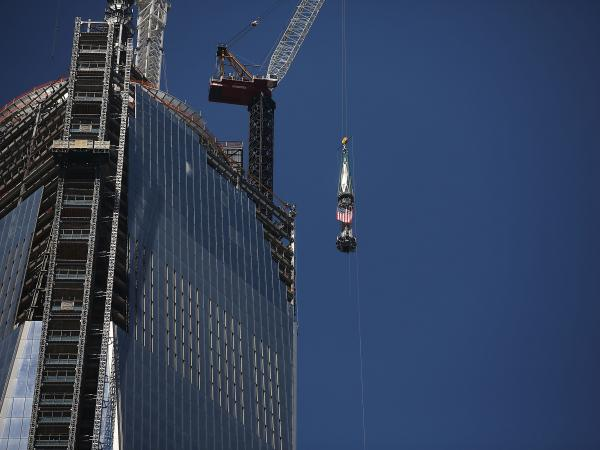 The 408-foot spire was hoisted onto a temporary platform at the top of One World Trade Center on Thursday.