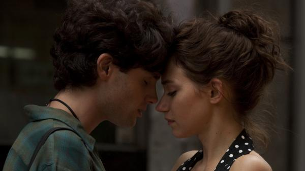 Jeff Buckley, played by Penn Badgley, and Allie, played by Imogen Poots, share a romantic moment in <em>Greetings from Tim Buckley</em>. Today, the younger Buckley is remembered as a brilliant musician who died a tragic, early death, but early in his life, he was overshadowed by his father, Tim — a musician who also died young.