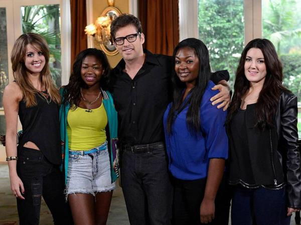 Harry Connick, Jr. (center) with the final four contestants on season 12 of <em>American Idol</em>. From left: Angie Miller, Amber Holcomb, Candice Glover and Kree Harrison.