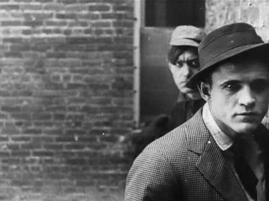 D.W. Griffith's <em>The Musketeers of Pig Alley</em> (1912) is thought to be the first gangster film.