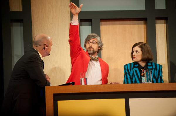 It's possible that Mo Rocca (c) is describing the show's popularity in this photo while chatting with <em>Wait Wait... Don't Tell Me! </em>Host Peter Sagal (l) and fellow panelist Paula Poundstone (r).