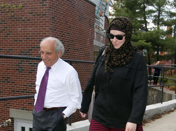 Katherine Russell leaves the law office of DeLuca and Weizenbaum with Amato DeLuca, last month.
