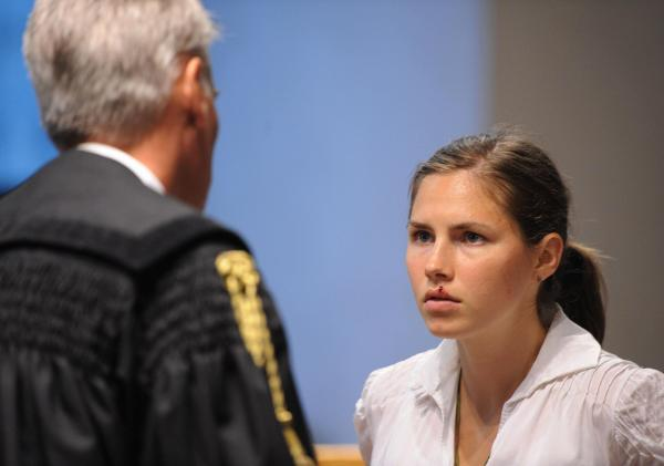 Amanda Knox listens to questions during her trial in Perugia, Italy, on June 12, 2009.