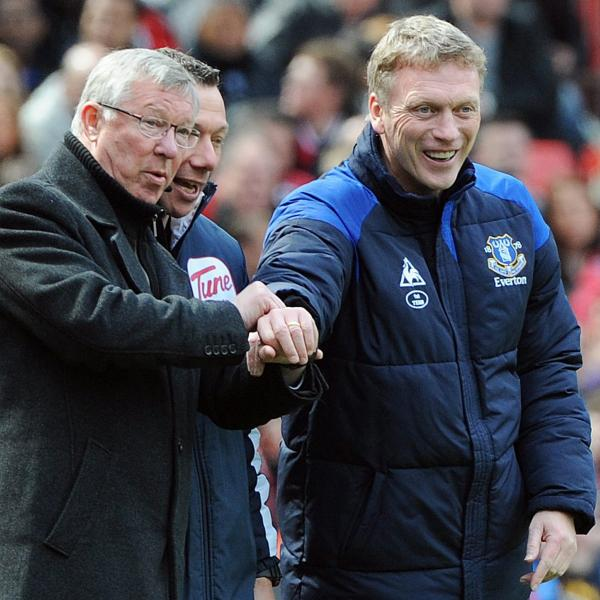 Manchester United manager Alex Ferguson (left) and Everton manager David Moyes (right) during a match in April 2012. Moyes will succeed the retiring Ferguson at Man United.