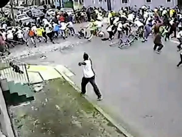 An image taken from a video released by New Orleans Police Monday shows a suspect in the Mother's Day parade shootings that left 19 people wounded.