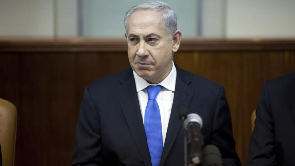 Israeli Prime Minister Benjamin Netanyahu heads the weekly Cabinet meeting in his office in Jerusalem on Monday. He's facing criticism for spending $127,000 of public money to outfit an El Al jet with a double bed plus a wall around it so he and his wife could rest well (and privately) on a flight to London last month.