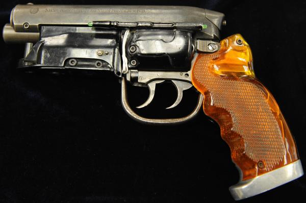 There's always a girl and there's always a gun: the Hero-Blaster used by Harrison Ford's character in the movie <em>Blade Runner</em>. The gun was up for auction in 2009.