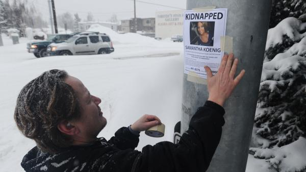 A family friend posts fliers after Samantha Koenig's disappearance in 2012. Koenig's father is now an advocate for a mandatory national missing persons database.