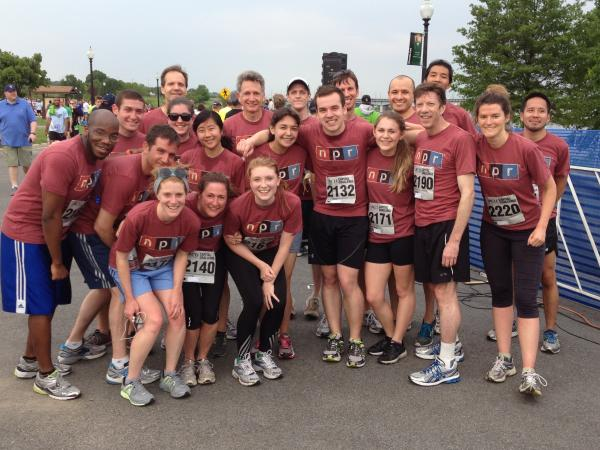 Sweaty but smiling, a group of NPR runners gather together after finishing the race.