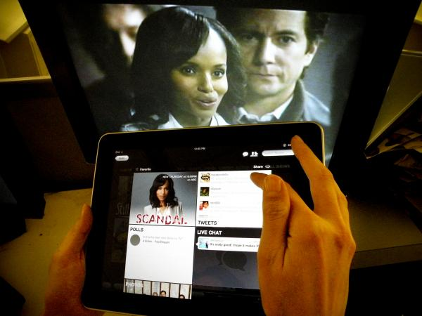 Kerry Washington from ABC's <em>Scandal</em> is shown on a TV monitor as an iPad displays the show page.