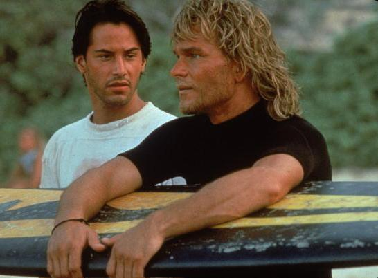 Actors Keanu Reeves and Patrick Swayze in Kathryn Bigelow's 1991 action film, <em>Point Break</em>.