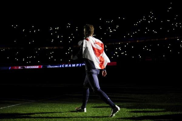 Paris Saint-Germain's English midfielder David Beckham walks away following the trophy giving ceremony after the French L1 football match between Paris St Germain and Brest on Sunday.