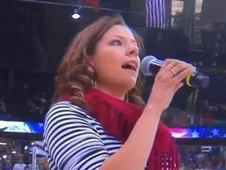 Alexis Normand sings the anthem.