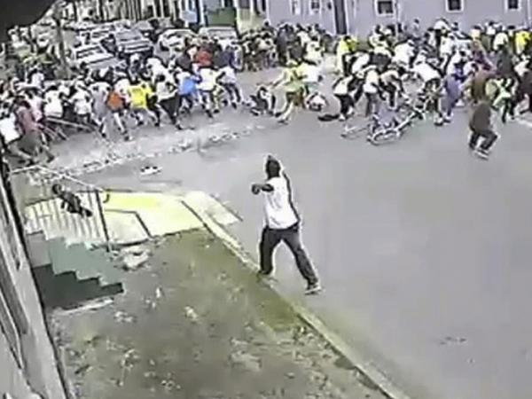 A possible shooting suspect in a white shirt (bottom center) shoots into a crowd of people on Mother's Day 2013 in New Orleans.