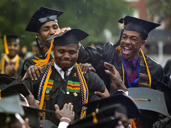 Morehouse graduate Leland Shelton is congratulated as he is acknowledged by President Obama.